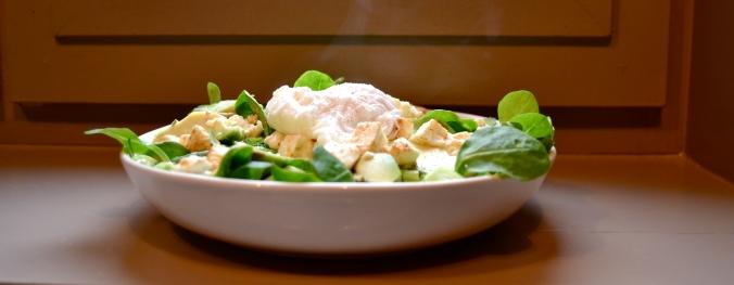 Poached egg, avocado and spicy feta salad.